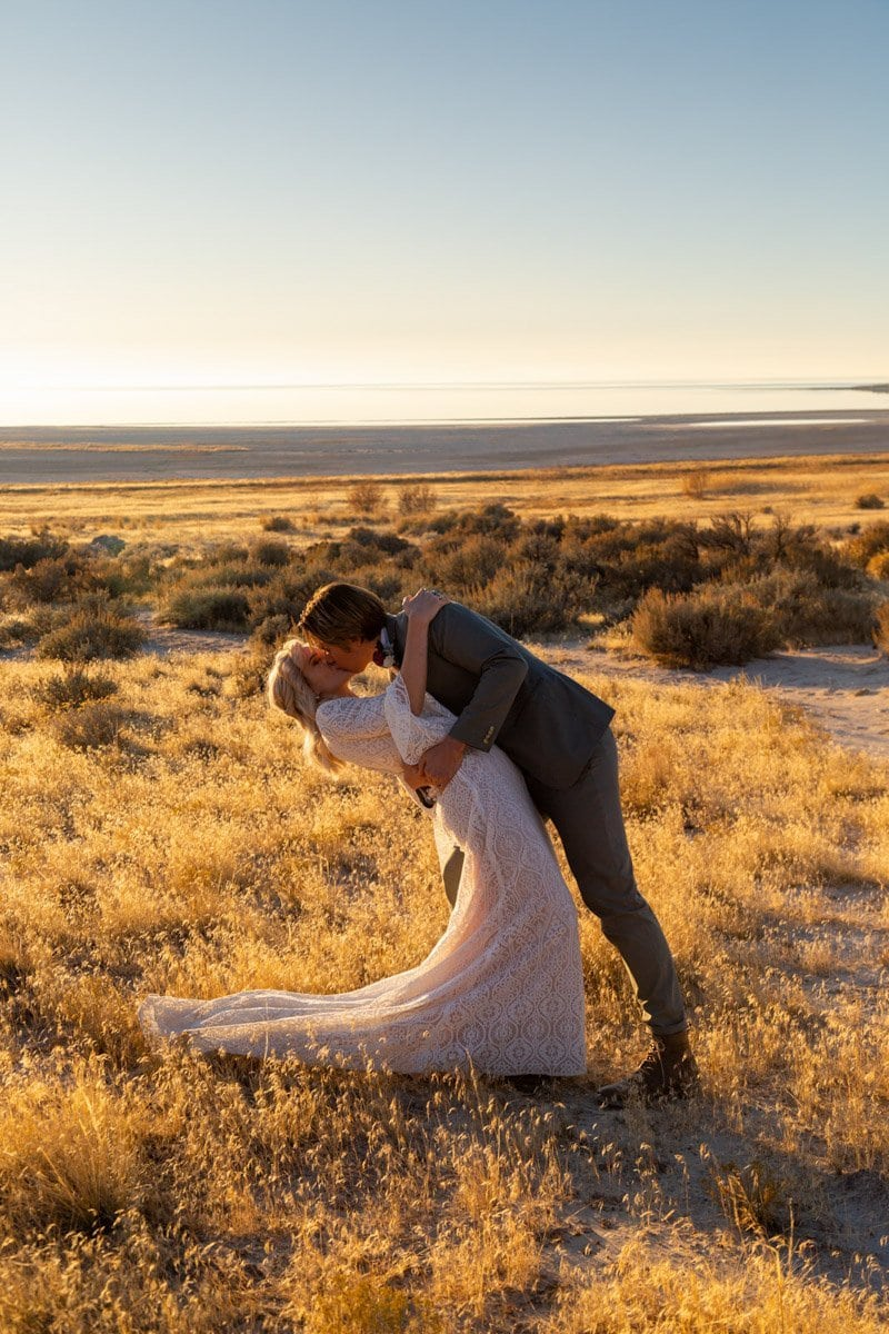 couple kiss and dip on antelope island state park