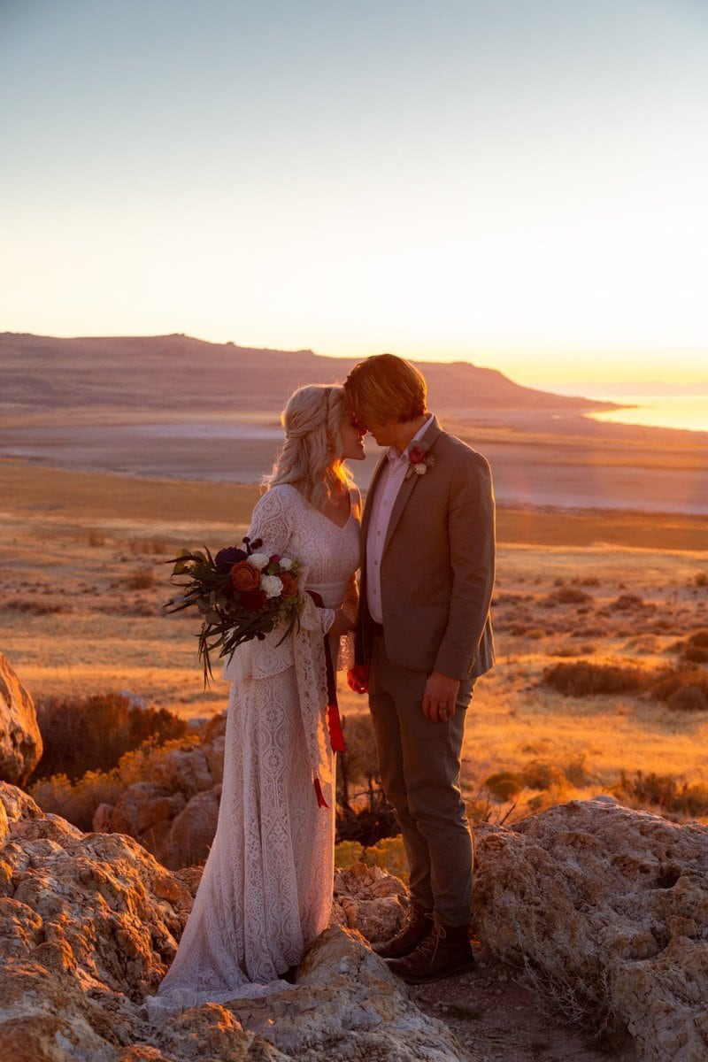 kissing at sunset for thier elopement