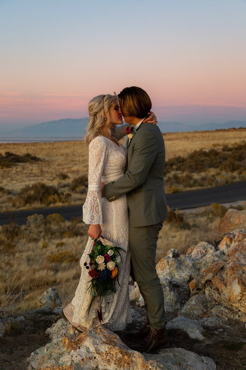 blue hour couple kiss on antelope island in utah