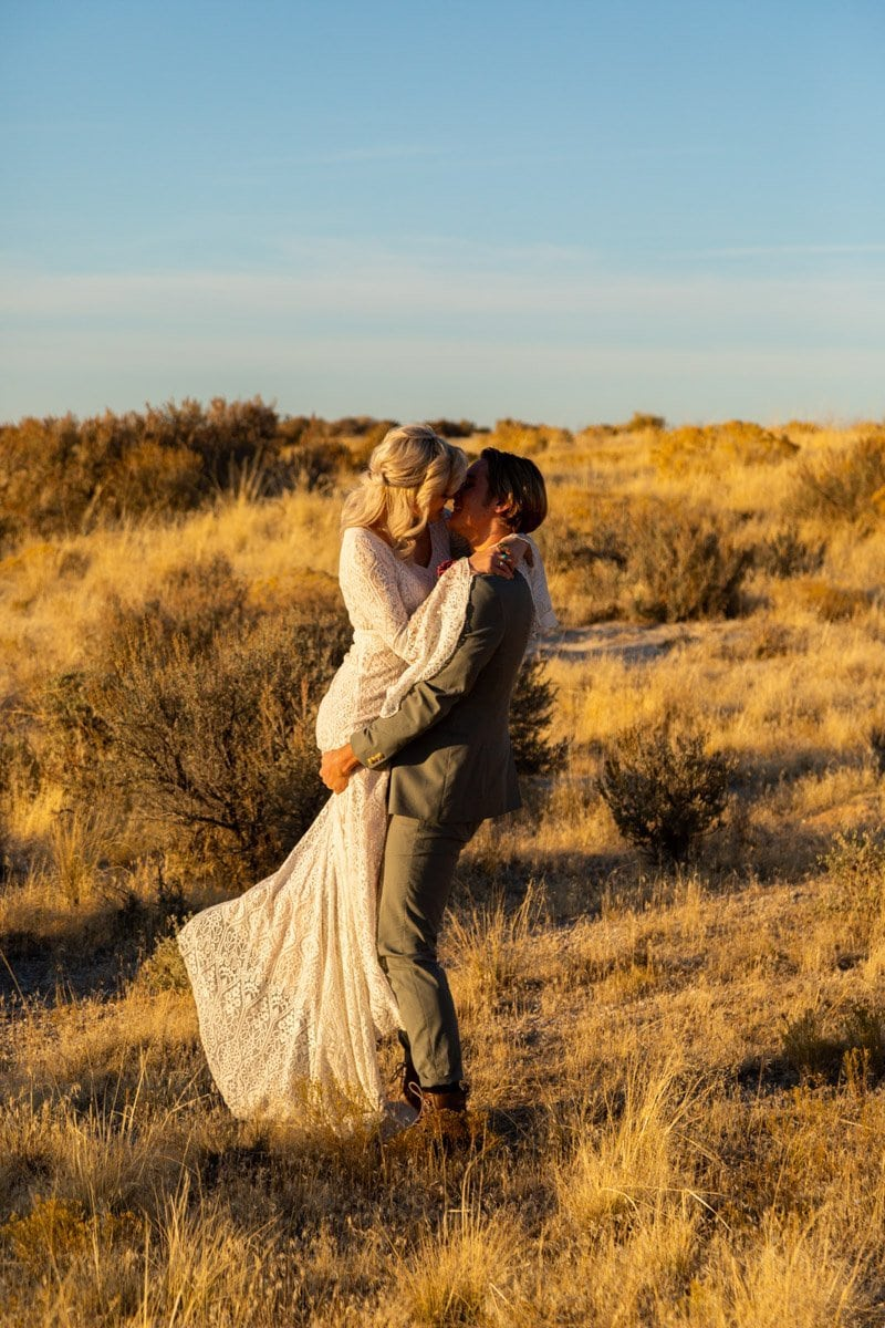 couple kissing in gold field