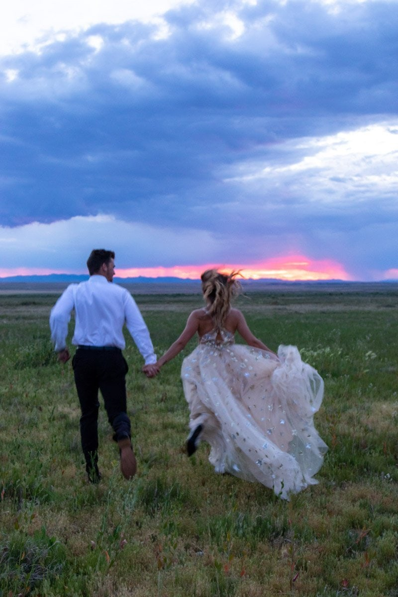 couple running into the sunset