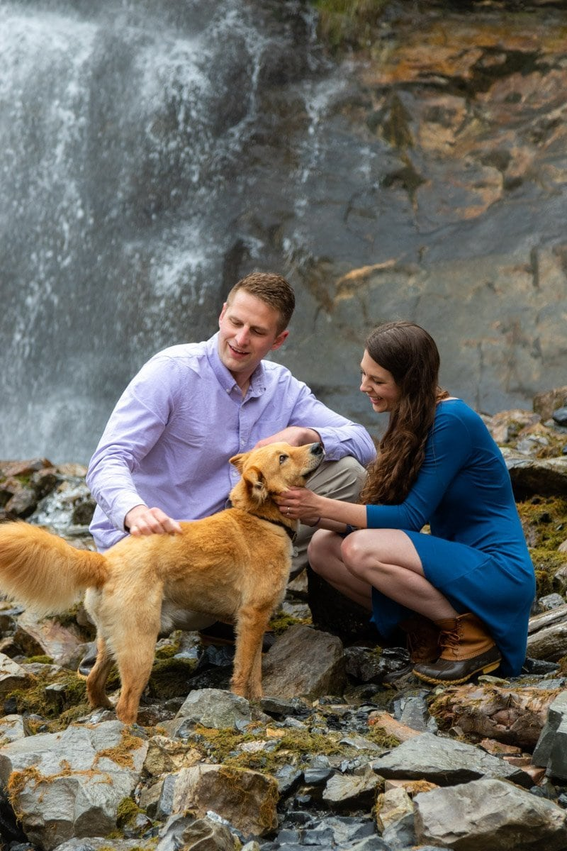 couple and dog at waterfall