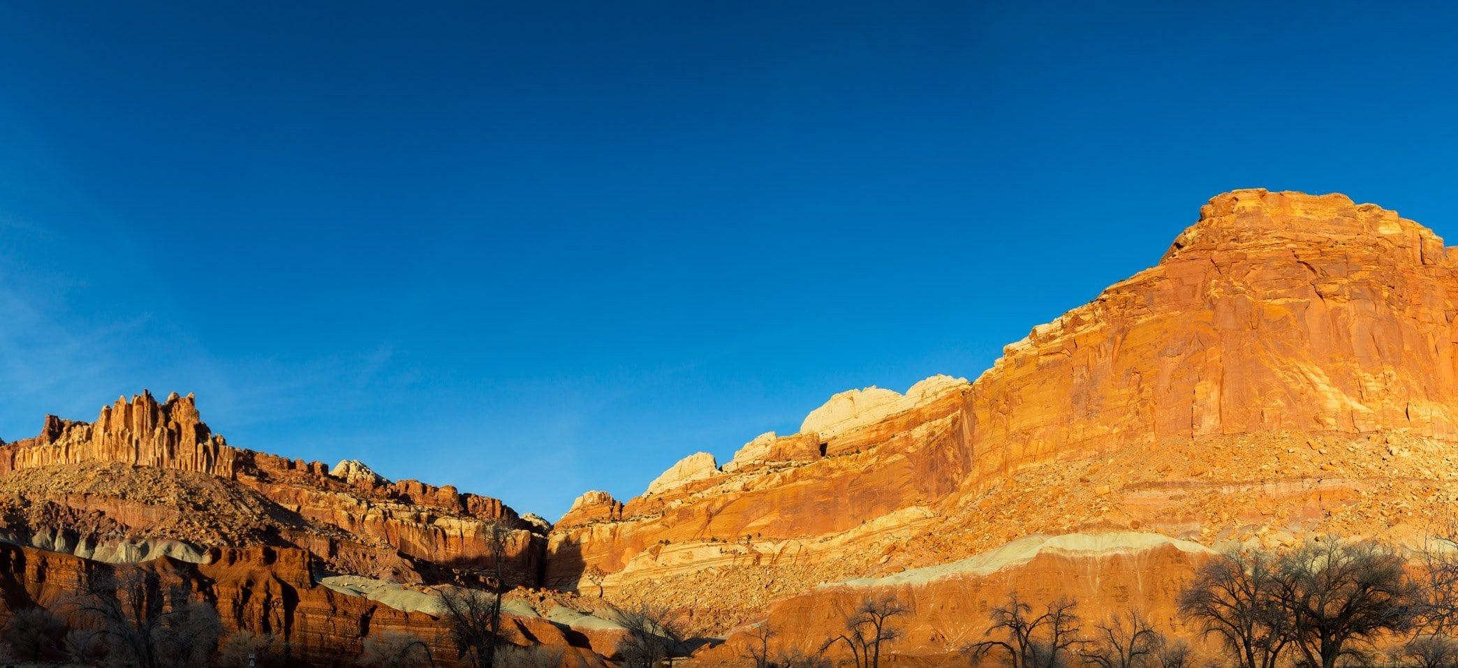 a gorgeous view of sandstone from the visitor center in capitol reef national park