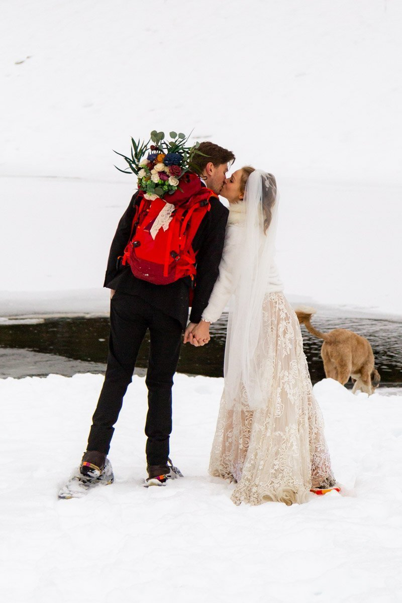 snowshoeing during their winter elopement in the wasatch mountains of utah