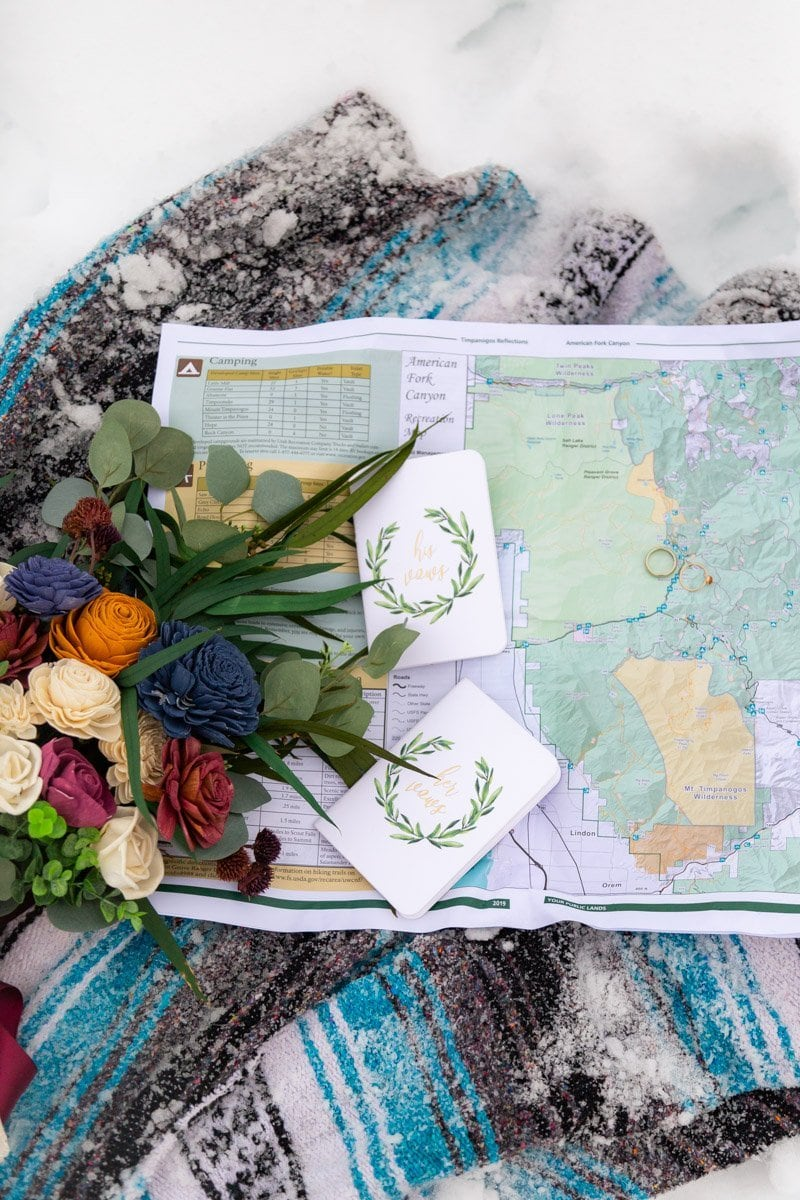 bouquet and wedding rigs over a map of american fork canyon in utah
