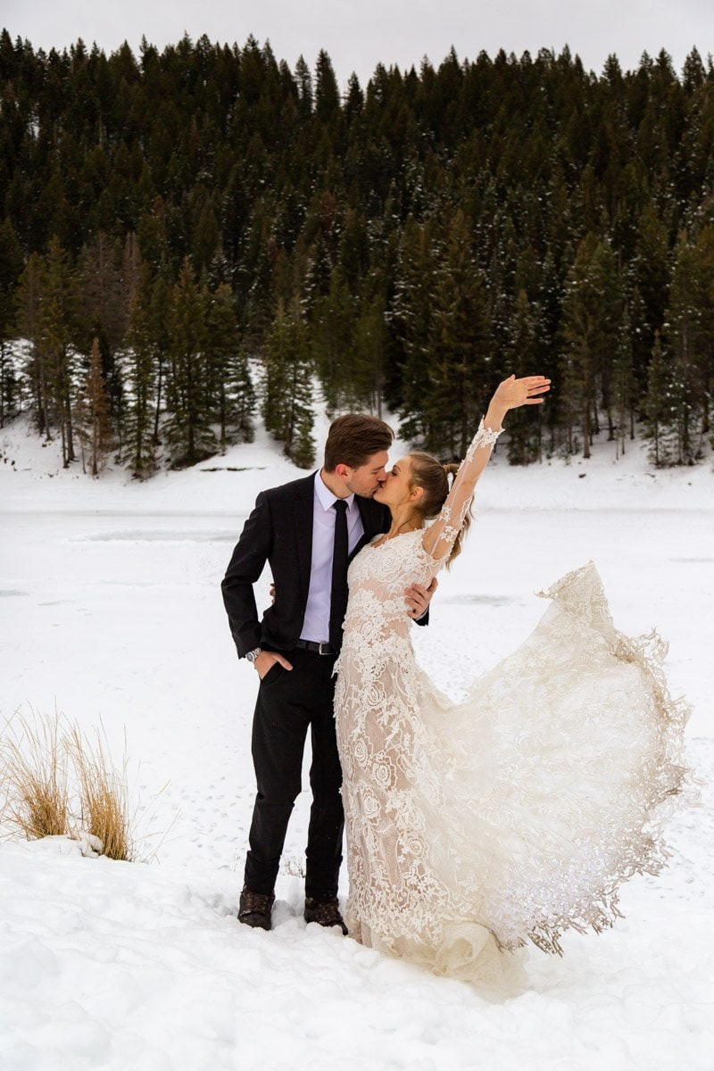 stunning dress flips in the snow among the trees in utah