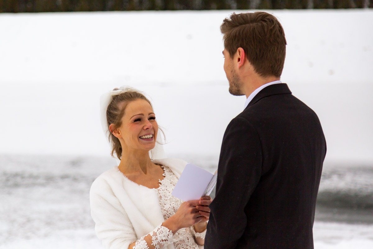 bride laughing during her vow readings