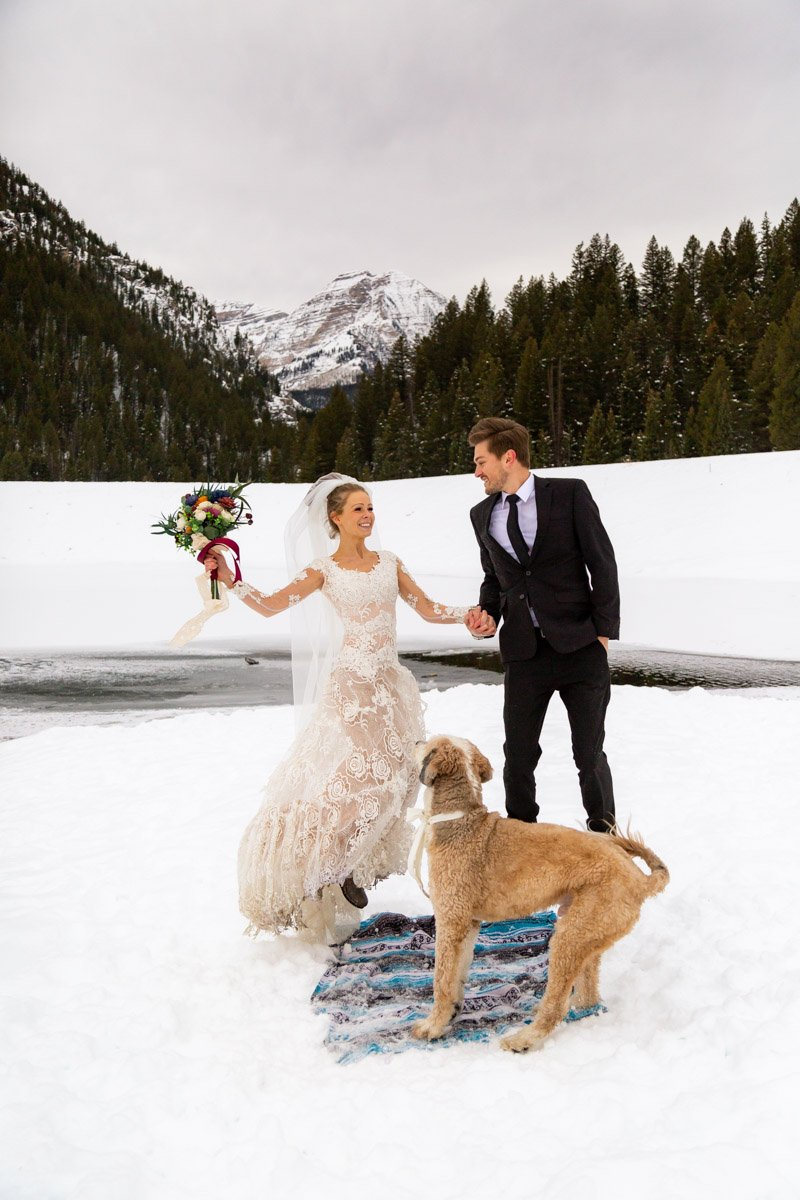 jumping for joy during their winter elopement