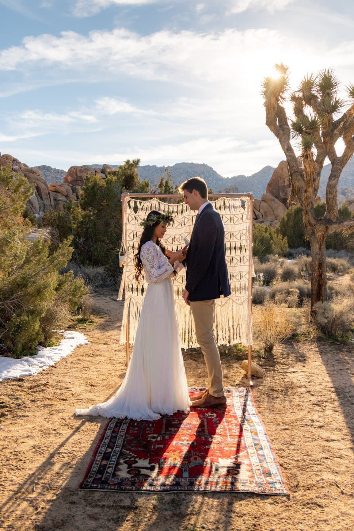 couple tears up while reading vows in the desert
