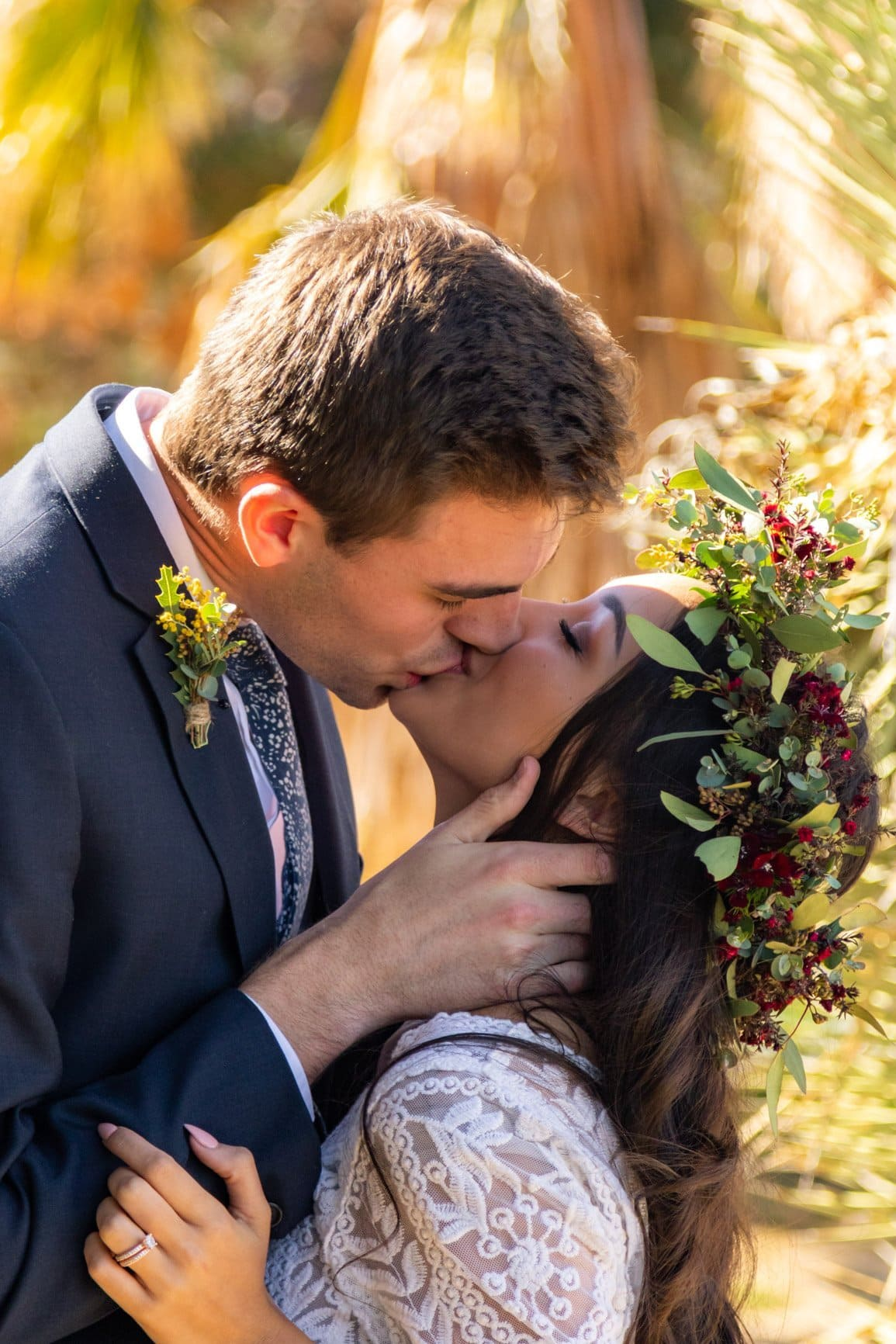 couple kisses after their first look for their elopement