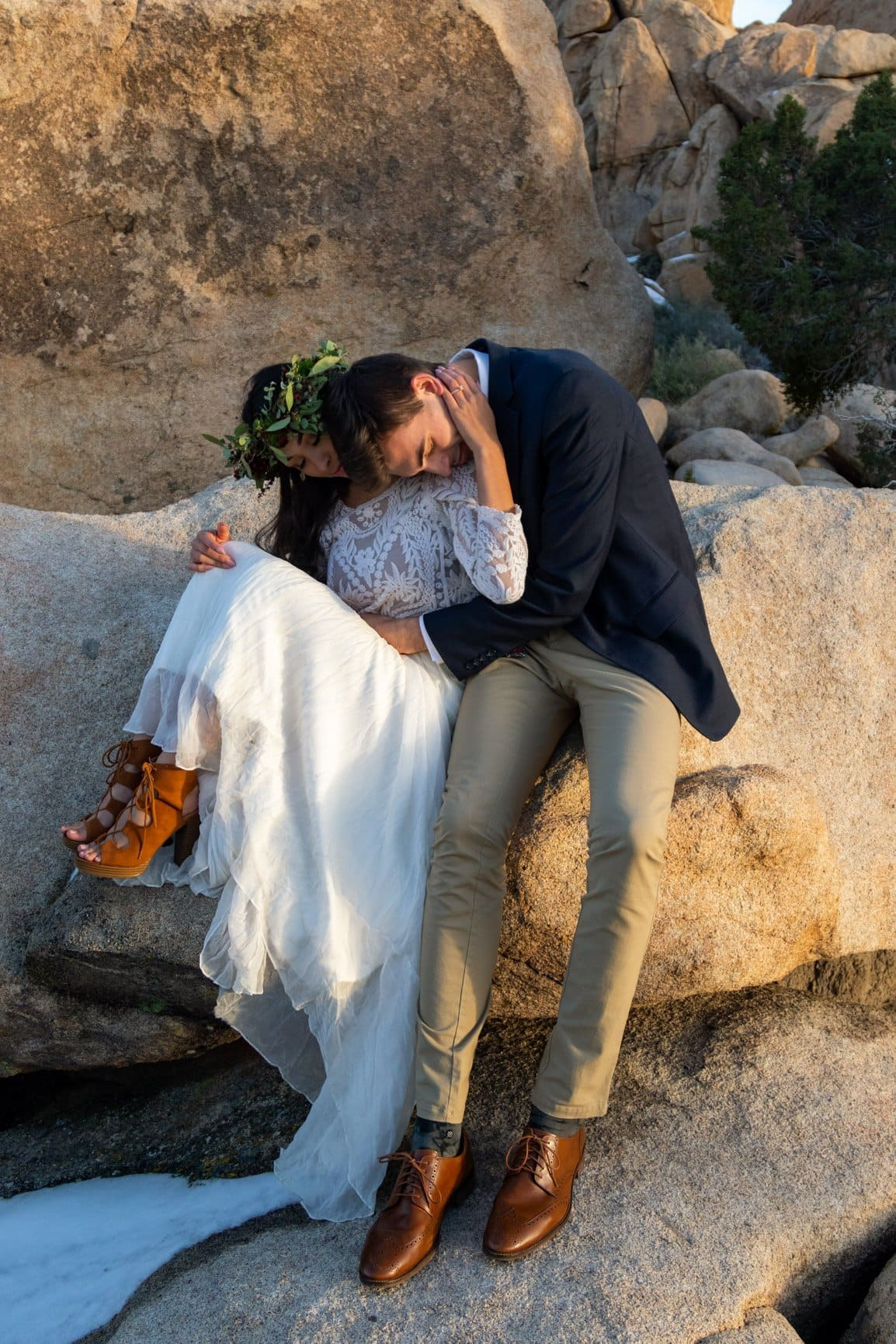 couple snugging in joshua tree after their elopement