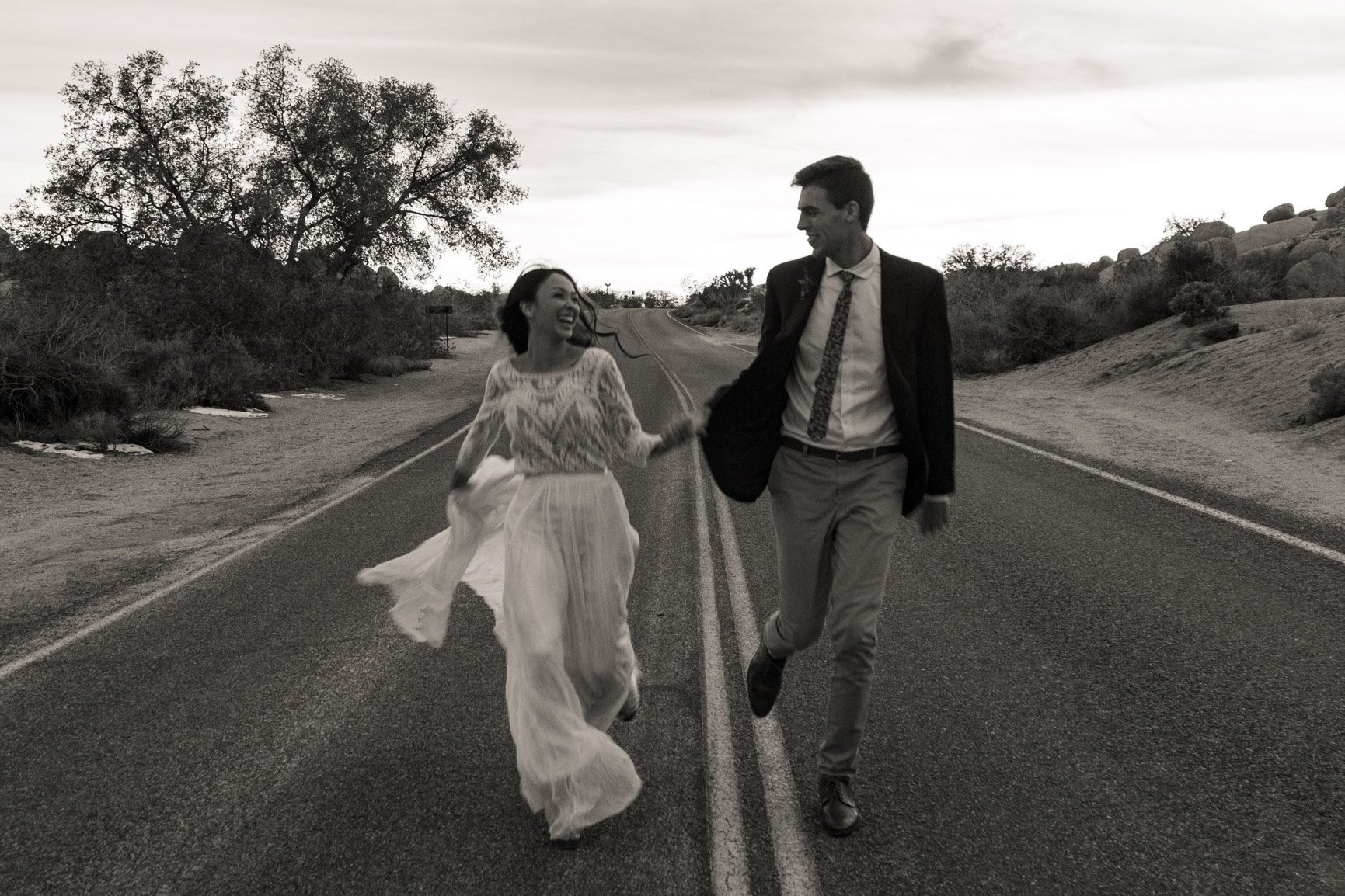 couple runs through the streets of joshua tree national park