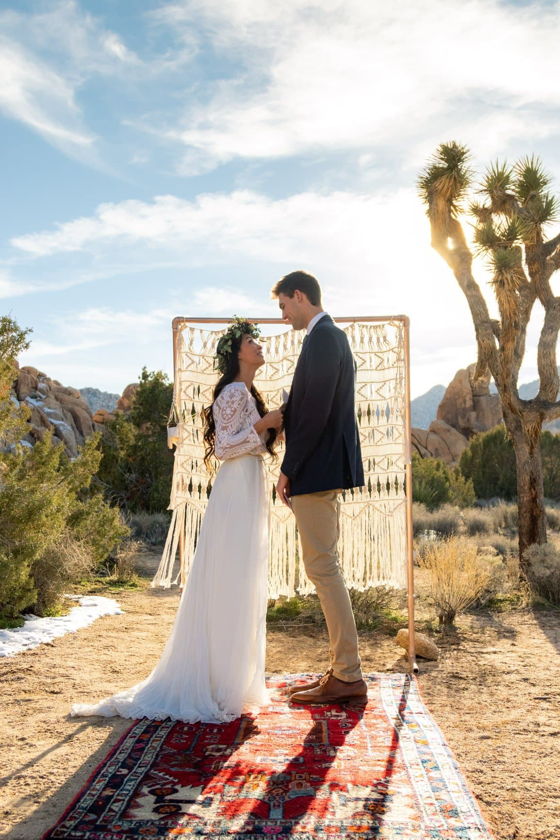 couple reads their vows in joshua tree national park