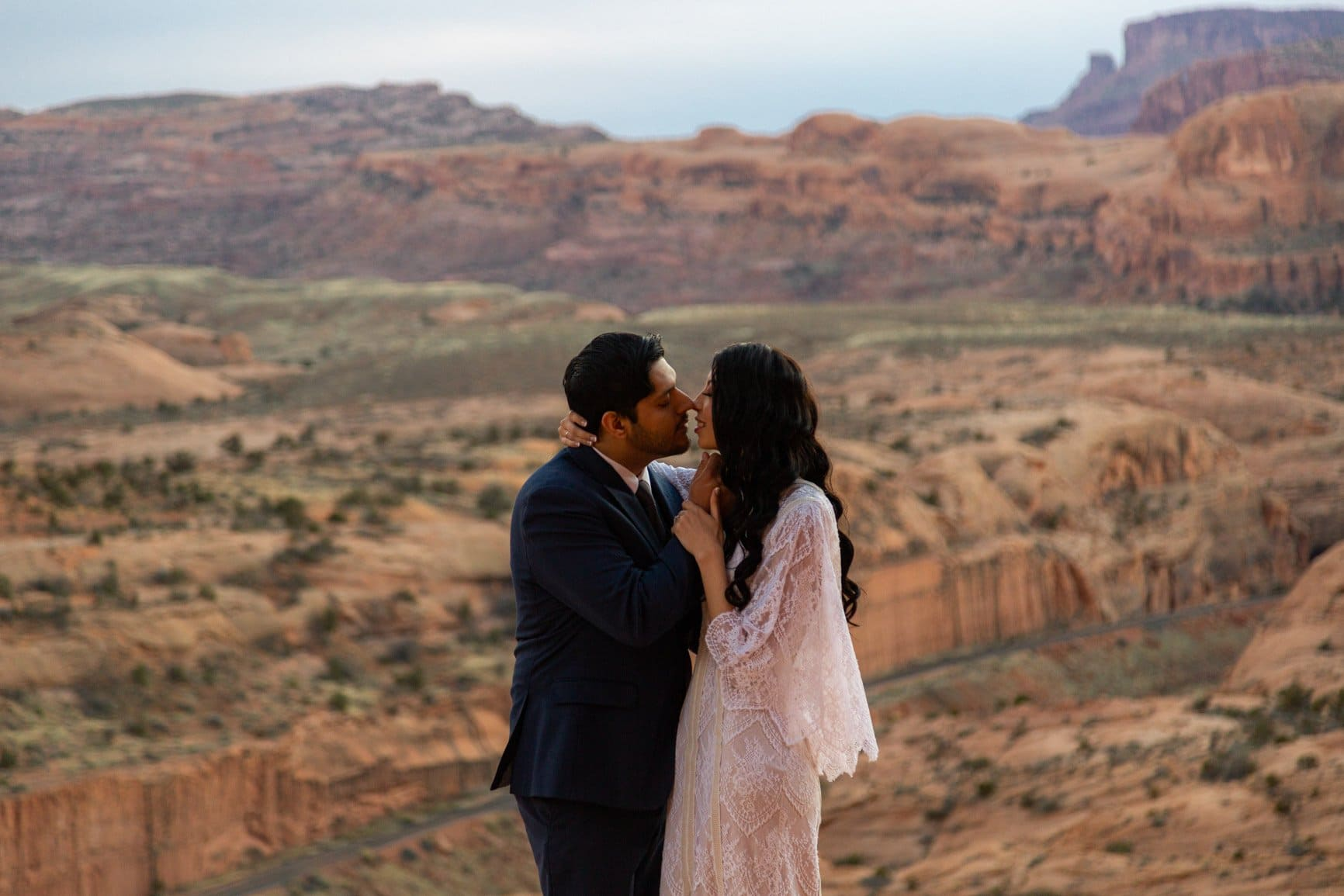 couple about to kiss during their elopement in moab