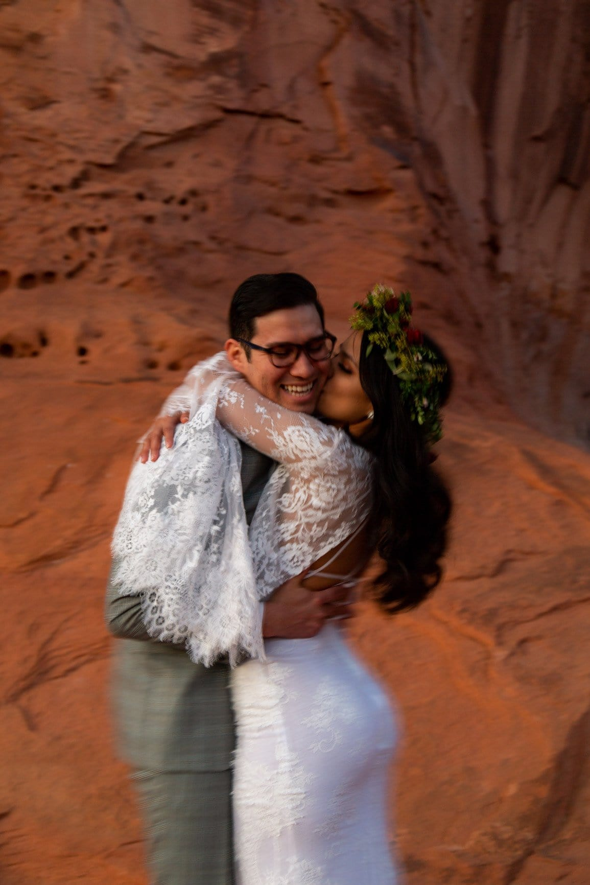 elopement couple kiss after their ceremony in moab