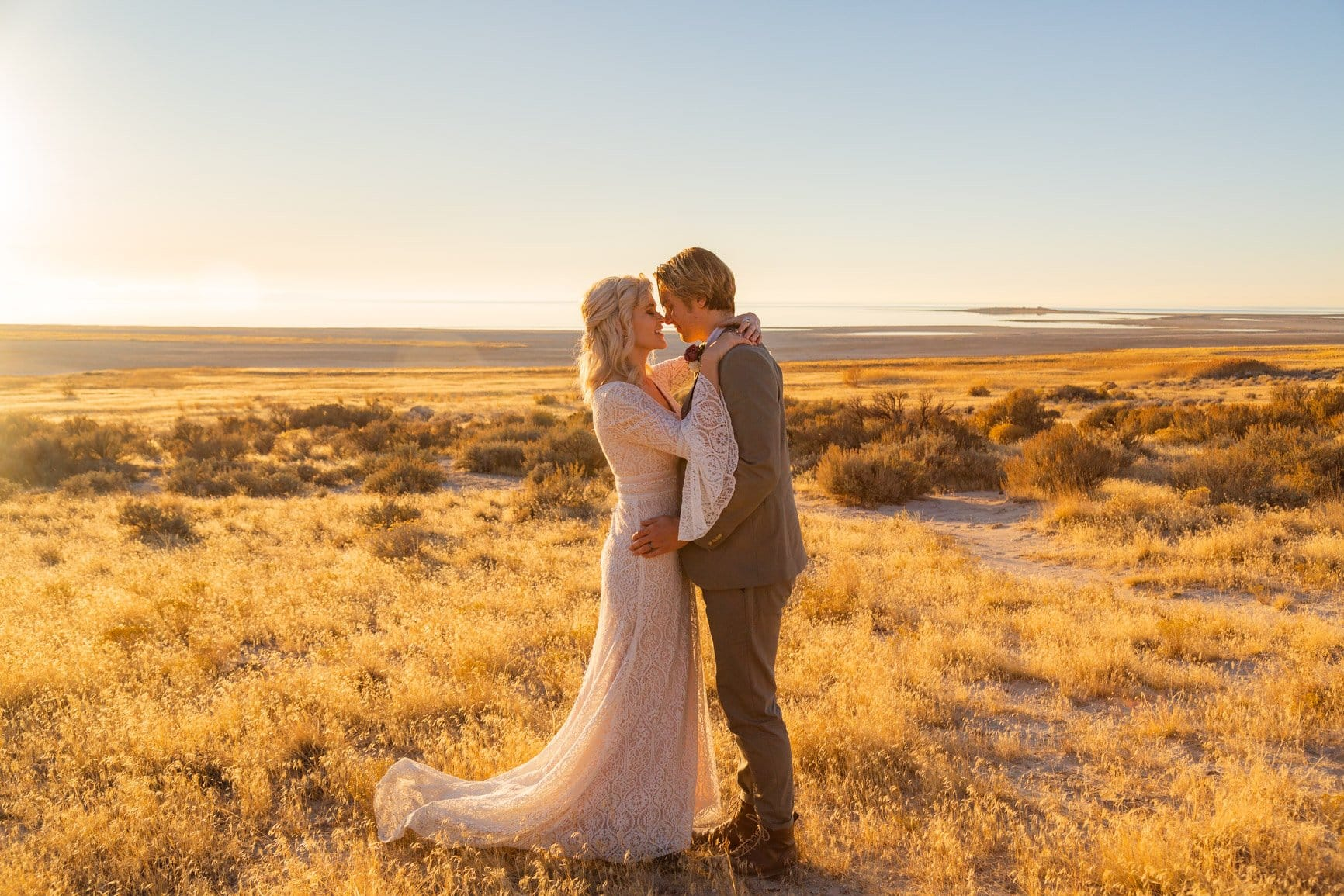 eloping couple embracing in antelope island state park