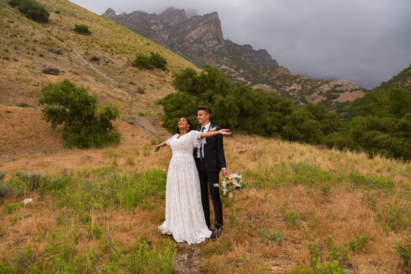 couple embraces the rain in provo canyon