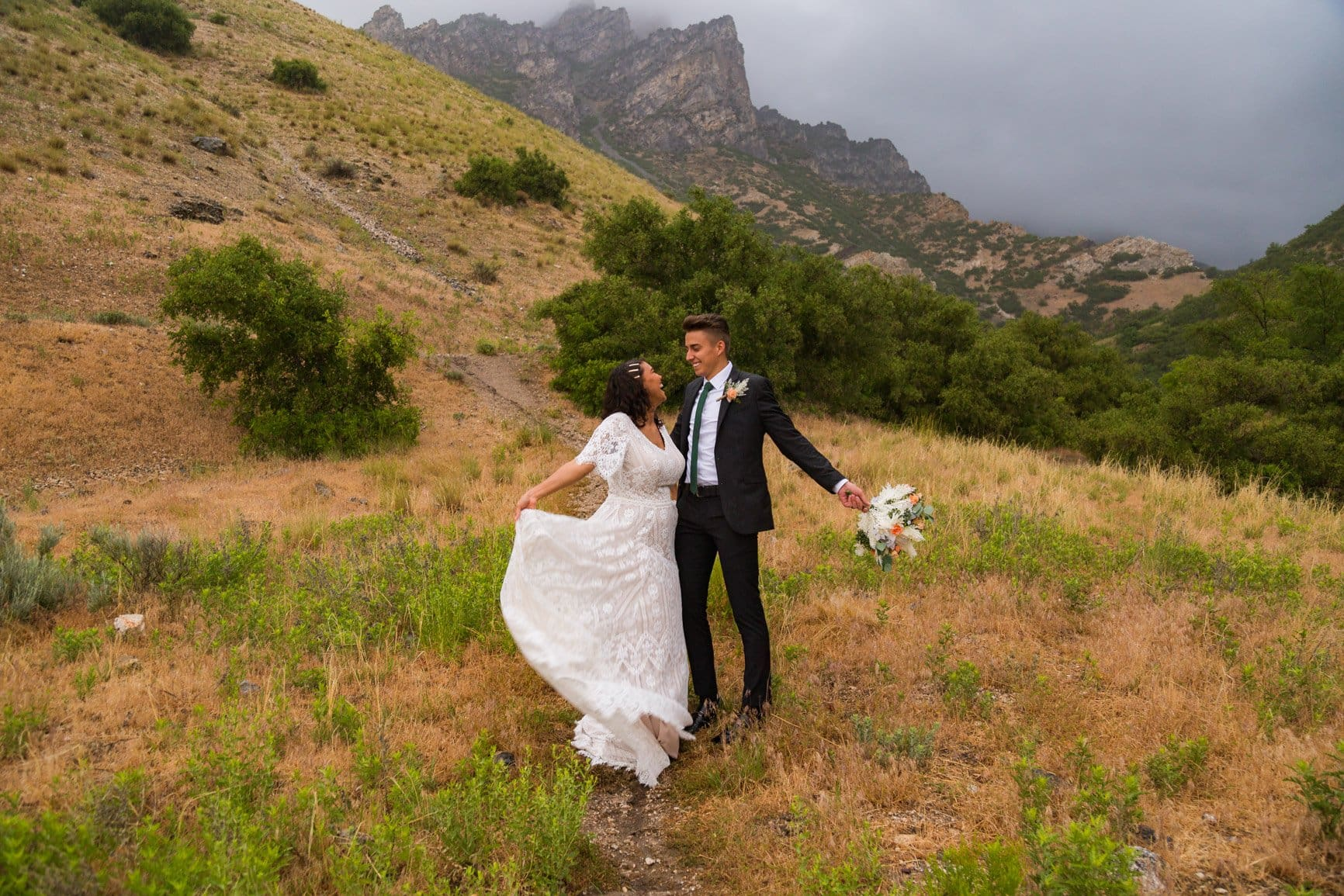 couple enjoys the rain during their vow renewal by embracing the rain in provo canyon