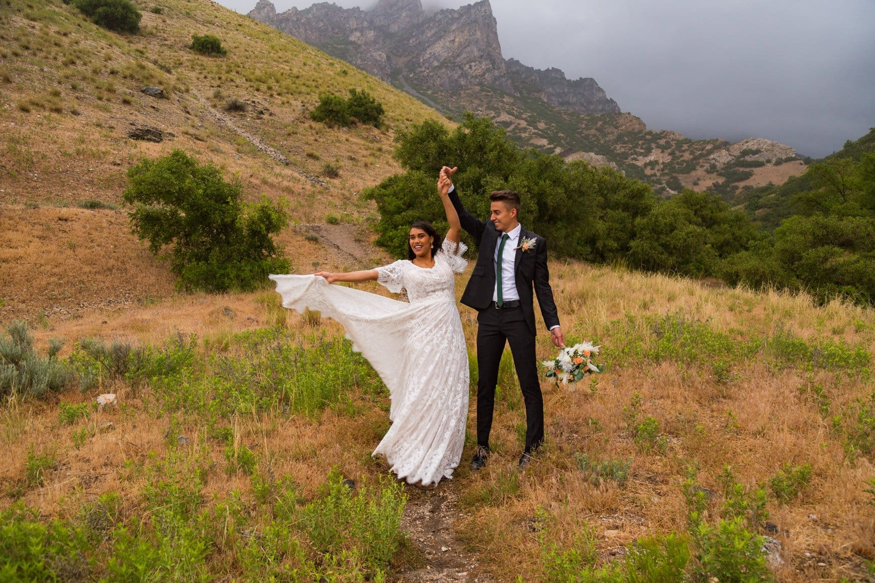 couple dances in the rain during their vow renewal in the storm