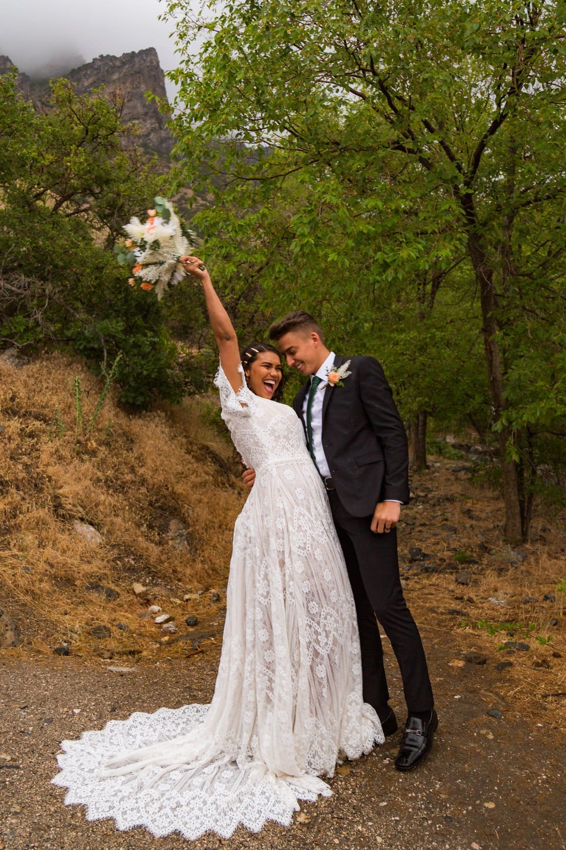 bride yells with joy over the love her her husband as they adventure in the outdoors