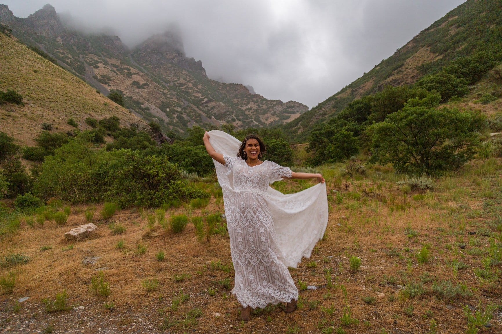 a beautiful women dances with the wind as the rain comes down in utah