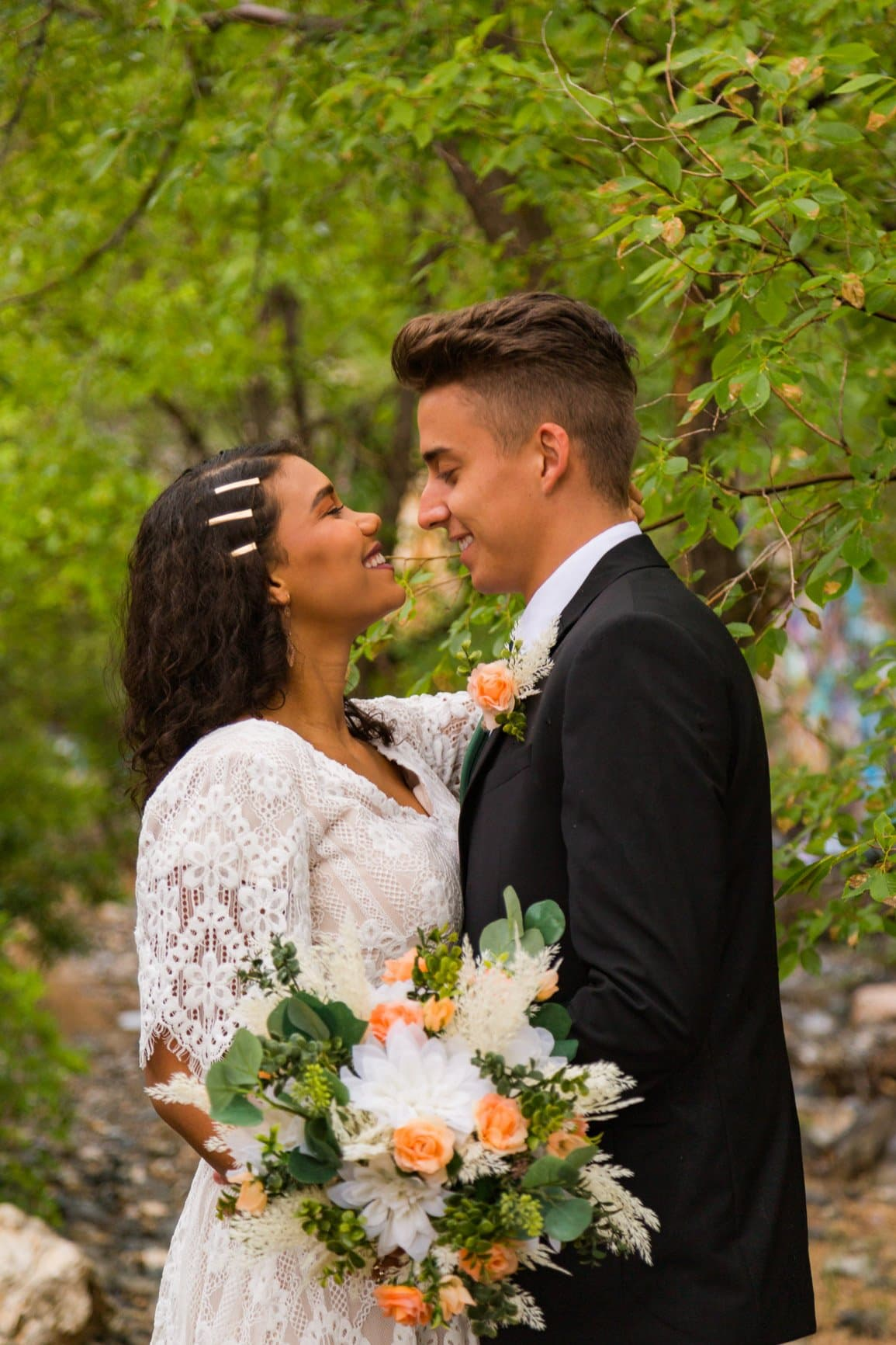 a beautiful couple stares at one another during their vow renewal