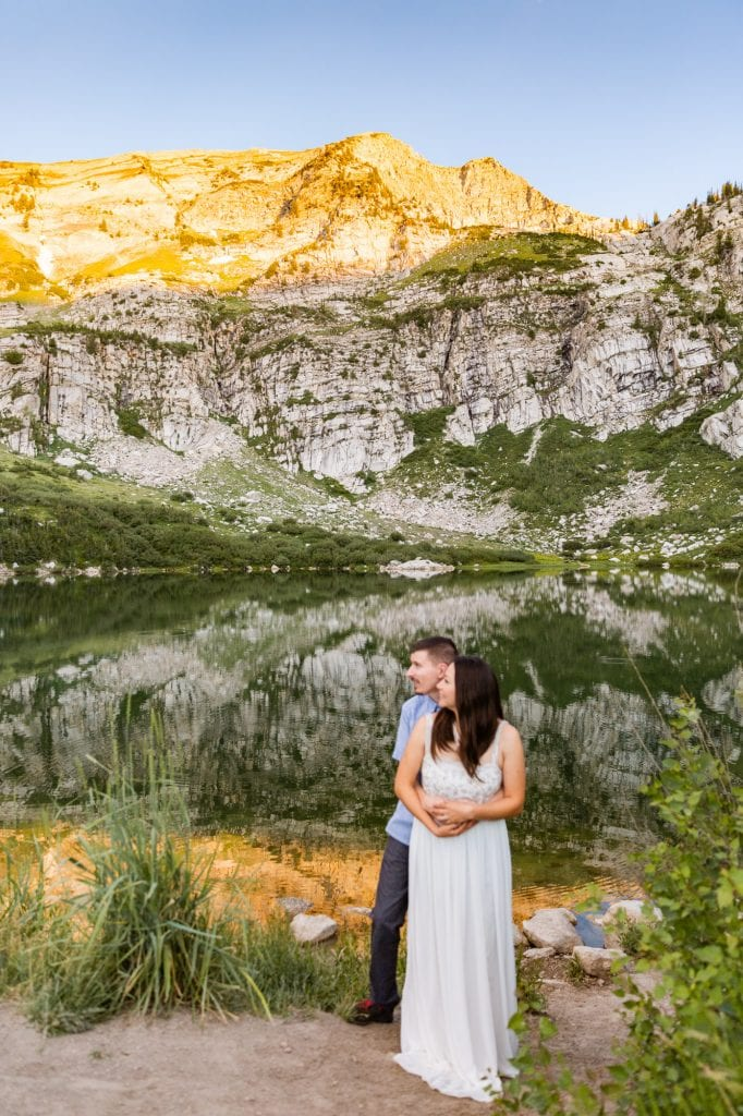 couple eloping at an alpine lake at sunrise