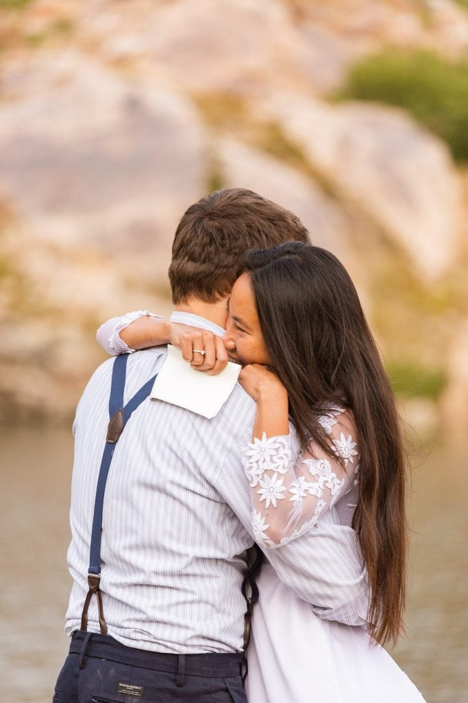 After your vows take time to embrace. These two got married in the Wasatch Mountains and said their touching vows at an alpine lake. Where will you say yours?