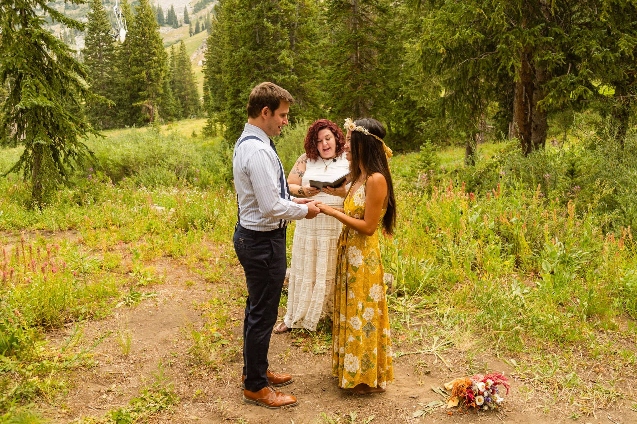 an eloping couple exchanges rings during their campground ceremony